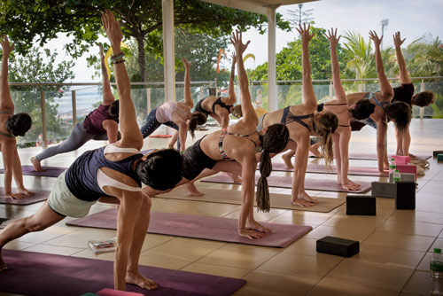 Student practice during the 200 hour yoga teacher training with Yoga Breeze Bali