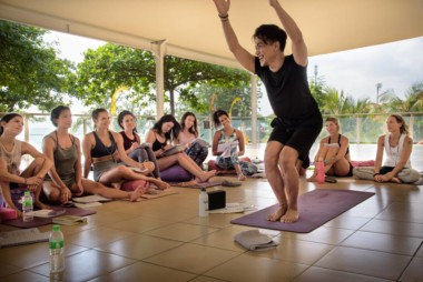 Diaz shows utkatasana cues for teacher training students