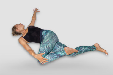 supta matsyendrasana or supine spinal twist pose