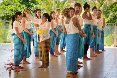 A new group of student yoga teachers at a typical Balinese blessing ceremony