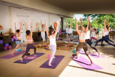 Yoga Breeze Bali students perform the ashta chandrasana posture