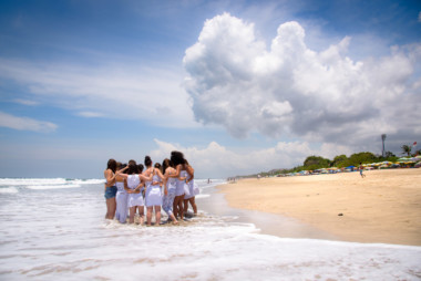 Students group hug of certified students after 25 days of yoga certification in Bali